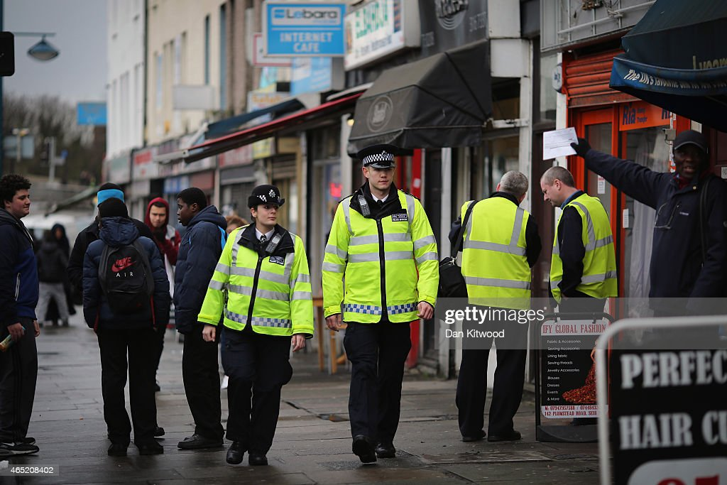 Police officers walk through Woolwich on February 26, 2015 in London, England.