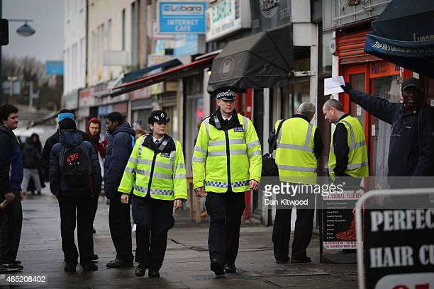 Police officers walk through Woolwich on February 26 2015 in London England