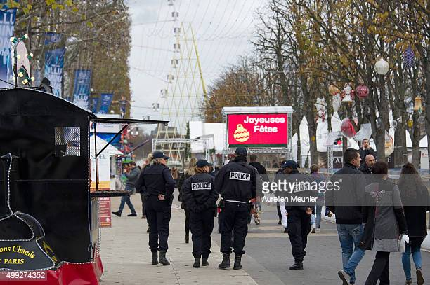 Police Officers walking down the ChampsElysee as roads across the city remain closed for COP21 on November 30 2015 in Paris France For the first day...