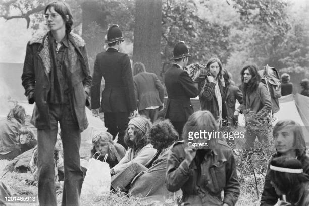 Police officers walking though the campsite at the Windsor Free Festival held in Windsor Great Park in Windsor Berkshire England 27th August 1972
