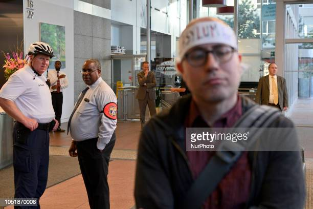 Police officers watch and wait as group of protestors block the entrance to the lobby of the Center City office of Sen Bob Casey in Philadelphia PA...