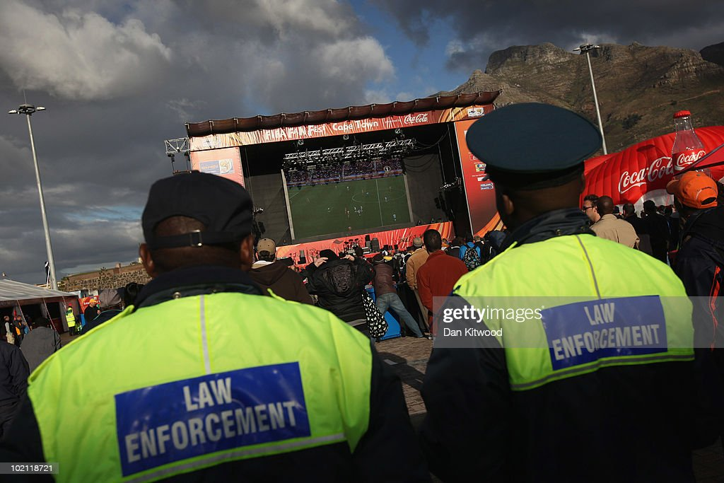 Police officers watch Ivory Coast v Portugal on a big screen in the Cape Town Fan Fest area on June 15, 2010 in Cape Town, South Africa. The excitement and passion of the South African people for the for the World Cup has increased following a draw in the opening match between South Africa and Mexico on June 11, with thousands joining the official Bafana Bafana fan club, but for many ordinary South Africans the tickets to the games remain unaffordable. The final is scheduled to be played on July 11.