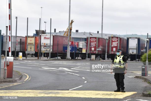 Police officers watch on as Loyalists hold a protest against the Northern Ireland Protocol and the so called Irish sea border at Belfast Harbour on...