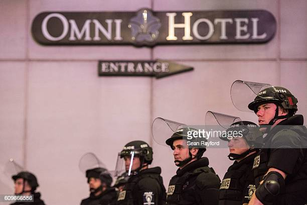 Police officers watch protests near the Omni Hotel September 22 2016 in downtown Charlotte NC The North Carolina governor has declared a state of...