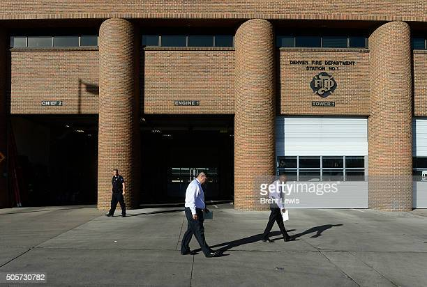 Police officers watch the trail of blood left outside of the Denver Fire Department Station 1 on January 19 2016 in Denver Colorado Denver Fire...