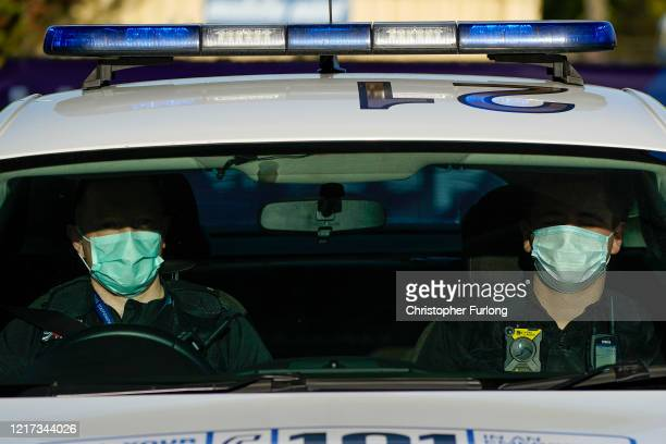 Police officers wear facial masks as they patrol during the pandemic lockdown on April 07 2020 in Wolverhampton United Kingdom There have been around...