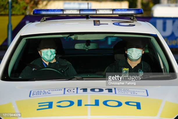 Police officers wear facial masks as they patrol during the pandemic lockdown on April 07, 2020 in Wolverhampton, United Kingdom. There have been...