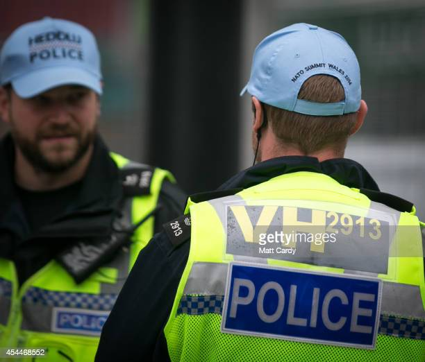 Police officers wear Nato Summit hats ahead of the Nato Summit 2014 that is being held in South Wales this week on September 1 2014 in Cardiff Wales...