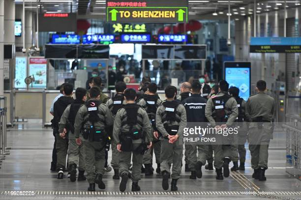 Police officers wearing facemasks as a preventative measure following a coronavirus outbreak which began in the Chinese city of Wuhan patrol at...