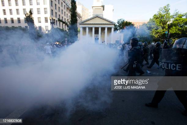 Police officers wearing riot gear push back demonstrators shooting tear gas next to St John's Episcopal Church outside of the White House June 1 2020...