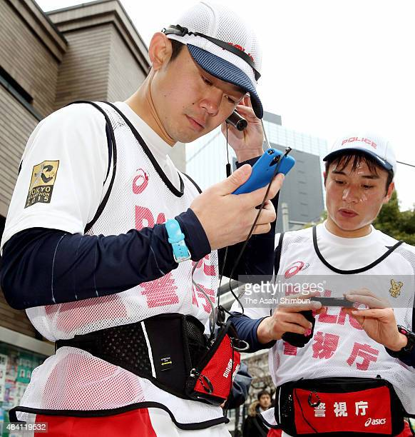 Police officers who patrol while running are seen during the Tokyo Marathon 2015 on February 22 2015 in Tokyo Japan