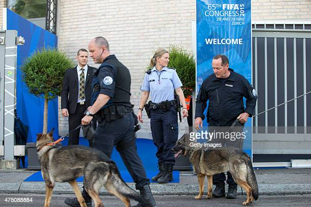 Police officers with dogs leave the Hallenstadion after searching a bomb during the 65th FIFA Congress at Hallenstadion on May 29 2015 in Zurich...