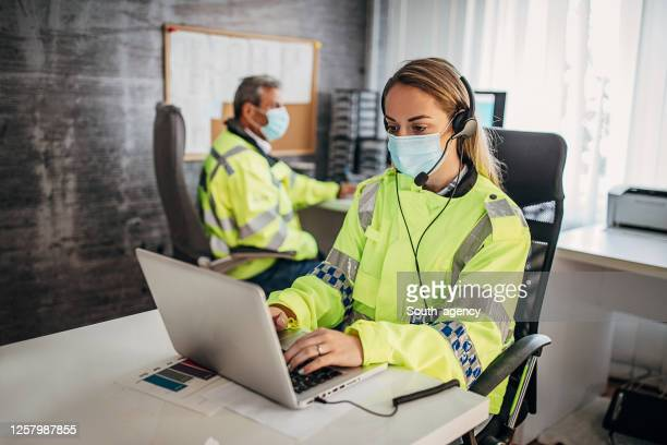 police officers with protective face mask working together in office - police force stock pictures, royalty-free photos & images