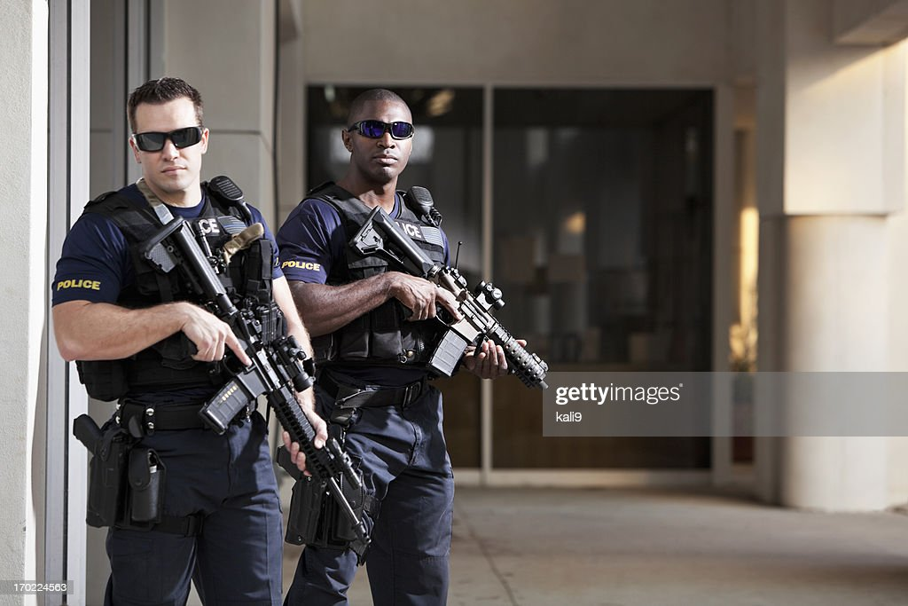 Police officers with rifles : Stock Photo