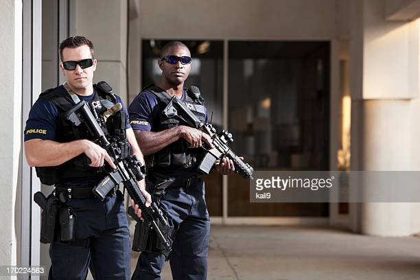 police officers with rifles - weaponry stock pictures, royalty-free photos & images