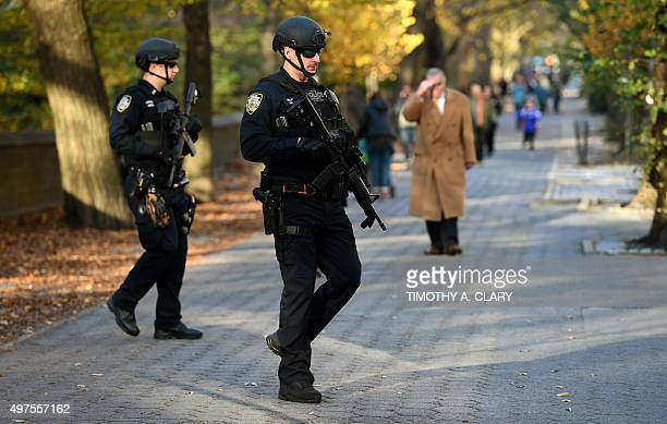 Police officers with the New York City Police Emergency Service Unit patrol in front of the French Consulate on 5th Avenue November 17 2015 Security...