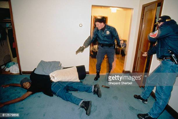 Police officers with the Violent Crime Response Team in the Washington DC Metropolitan Police Department arresting a suspected drug dealer in his...