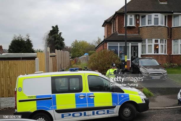 Police officers work at the rear of a property on Shipton Road in Sutton Coldfield West Midlands where detectives have begun a search for the body of...