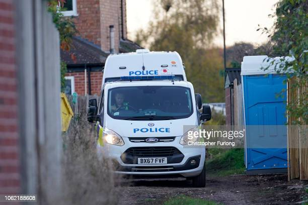 Police officers work at the rear of a property on Shipton Road in Sutton Coldfield West Midlands where detectives are continuing their search for the...