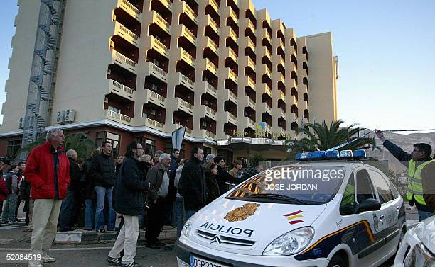 Police officers work at the scene at the Mediterranean resort Port Denia Hotel in Denia where a bomb exploded 30 January 2005 injuring two people....