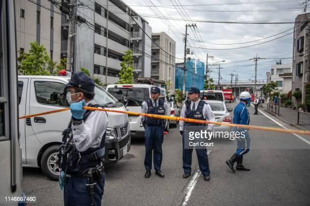 Police officers work at the scene of a mass stabbing on May 28, 2019 in Kawasaki, Japan. Around sixteen people, including children, were injured...