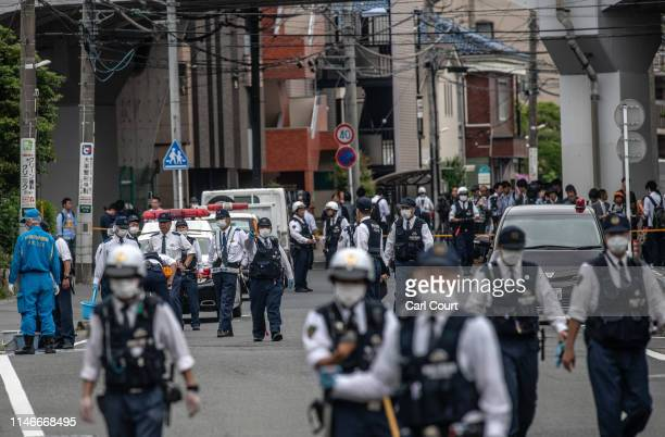 Police officers work at the scene of a mass stabbing on May 28, 2019 in Kawasaki, Japan. A schoolgirl and a 39-year-old man were killed by a...