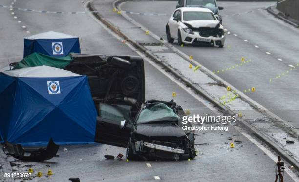 Police officers work at the scene of a multivehicle crash on Lee Bank Middleway Edgbaston in Birmingham which left six people dead and a seventh...