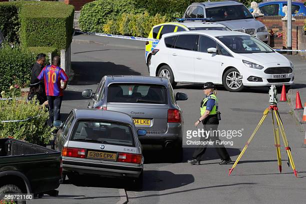 Police officers work in Meadow Way Trench Telford at the scene where former Aston Villa player Dalian Atkinson was tasered by police on August 15...
