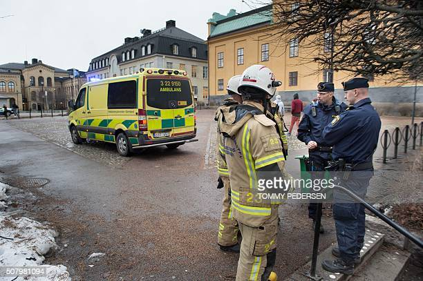 Police officers work outside the Tingvalla secondary School in Karlstadt on February 2 2016 A loud explosion has been heard inside the secondary...