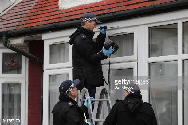 Police Officers work to recover a bullet from the scene where a 17 year old girl was shot and killed in Northumberland Park on April 4 2018 in London...
