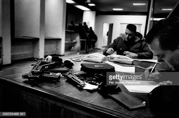 police officers write report in a police station johannesburg, south africa - 1999 stock pictures, royalty-free photos & images