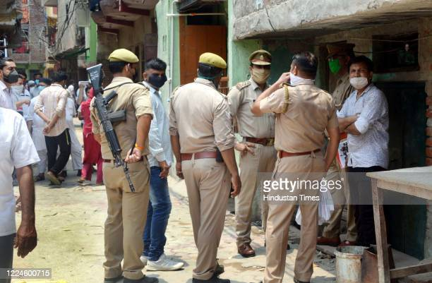 Police officials arrive to investigate a crime scene in a locality where a father and daughter were found dead, at Shaheed Nagar on July 3, 2020 in...