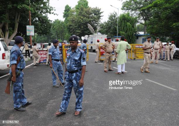 Police officials cordon off the entrance to former Railway Minister Lalu Prasad Yadav's residence while the CBI conducts raids on July 7 2017 in...
