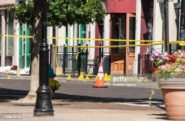 Police officials cordon off the scene after a gunman opened fire on a crowd in Dayton Ohio United States on August 4 2019 At least 10 people were...