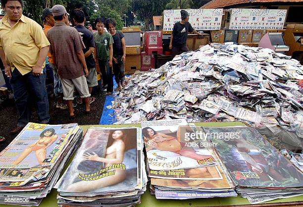 Police officials prepare to destroy pornographic magazine and Video Compact Discs at the police headquarters in Jakarta 09 February 2006 The...
