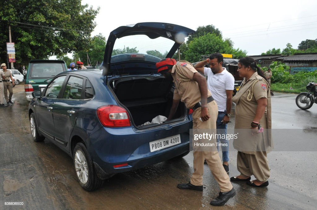 Police officials searching vehicles on August 25 2017 in Jalandhar India The godman Gurmeet Ram Raheem Chief of Dera Sacha Sauda was charged with...