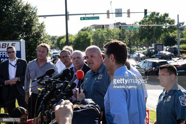 Police officials speak to media after multiple people have been fatally shot and wounded when a gunman opened fire at the Capital Gazette newsroom in...