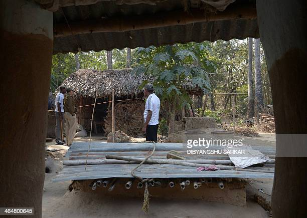 Police officials stand near the alleged crime scene following a gangrape in Subalpur village in Birdhum district some 240 kilometres north west of...