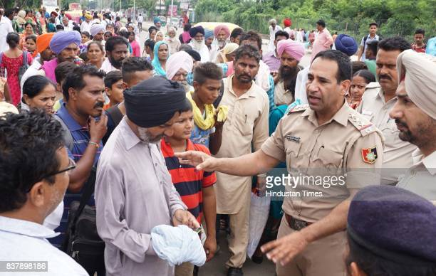 Police officials trying to guide the followers of Dera Sacha Sauda to go their destination for the support of Dera Chief Sant Gurmeet Ram Rahim Singh...