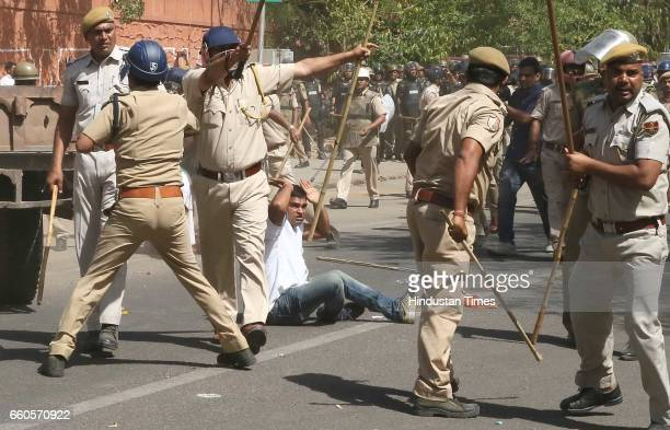 Police officials use force to disperse an aggressive rally of Youth Congress supporters and members demanding waiver of farmers' loans near state...