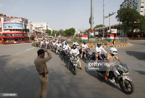 Police officials wearing protective mask , prepares to go for inspection during the nationwide lockdown imposed by Government as a preventive measure...