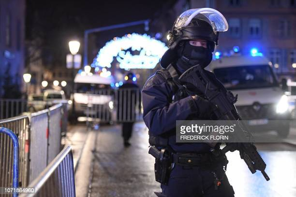 A police officier stands in the streets of Strasbourg eastern France after a shooting breakout on December 11 2018 Two person has been killed and 12...