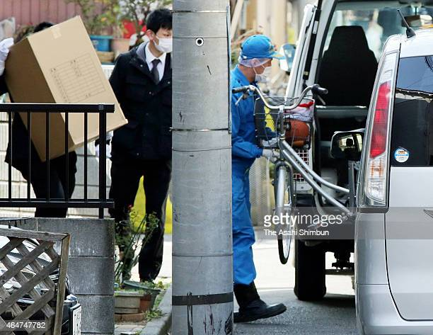 Police offiers raid a home of a suspect on February 28 2015 in Kawasaki Japan Three teenagers one 18yearold and two 17yearold were arrested on...