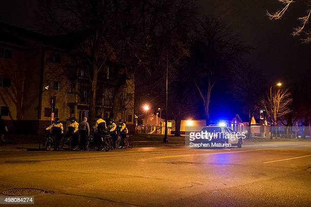 Police on bicycles gather a block in front of a group of Black Lives Matter activists marching down Plymouth Avenue protesting the death of Jamar...