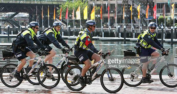 Police on bicycles patrol around the Sydney Convention and Exhibition Centre 06 September 2007 ahead of the AsiaPacific Economic Cooperation leaders'...