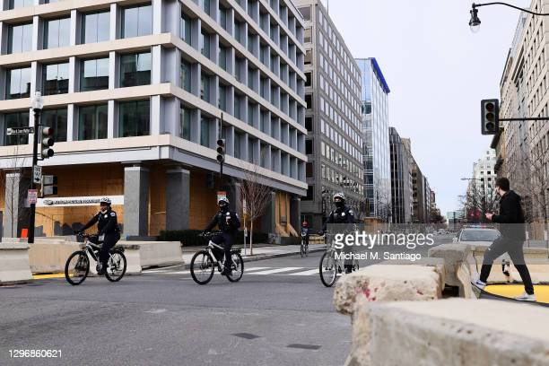 Police on bikes ride past Black Lives Matter plaza on January 17, 2021 in Washington, DC. After last week's riots at the U.S. Capitol Building, the...