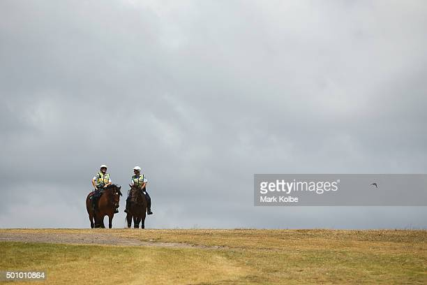 Police on horse back look on as Party for Freedom supporters gather at Wanda beach Cronulla during a BBQ on December 12 2015 in Sydney Australia...