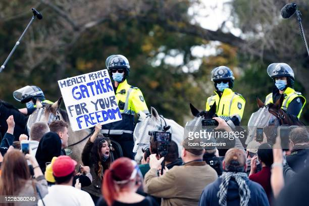 Police on horseback are seen as they make an attempt to disperse the protestors during the Anti-Lockdown Protest on September 05, 2020 in Melbourne,...