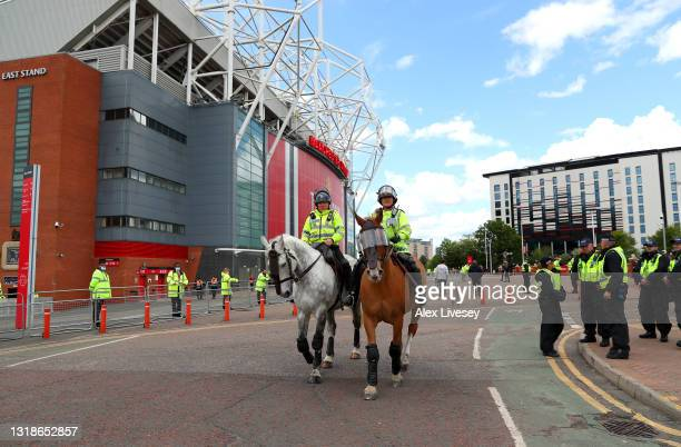 Police on horseback are seen outside the stadium prior to the Premier League match between Manchester United and Fulham at Old Trafford on May 18,...