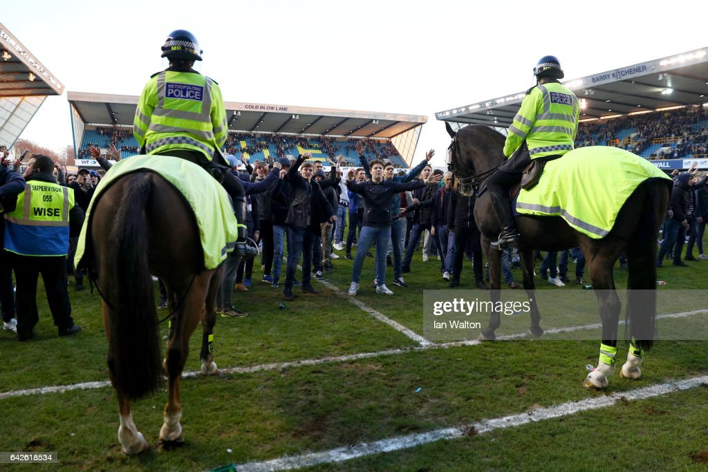 Police on horseback control the pitch invaders during The Emirates FA Cup Fifth Round match between Millwall and Leicester City at The Den on February 18, 2017 in London, England.